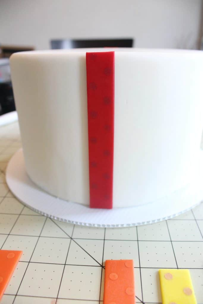 Attaching first strip of fondant