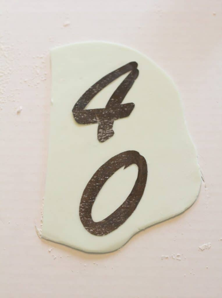 Using a template for the fondant number topper