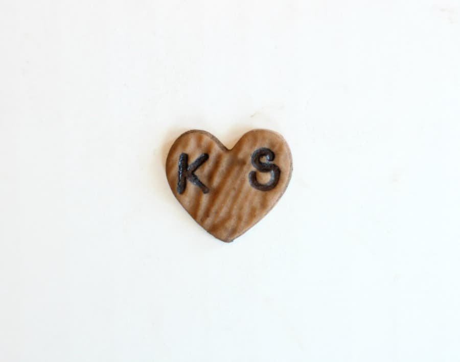 stamping initials on fondant woodgrain cupcake toppers