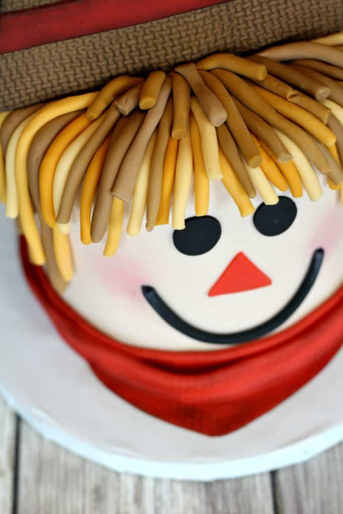 finishing the scarecrow cake