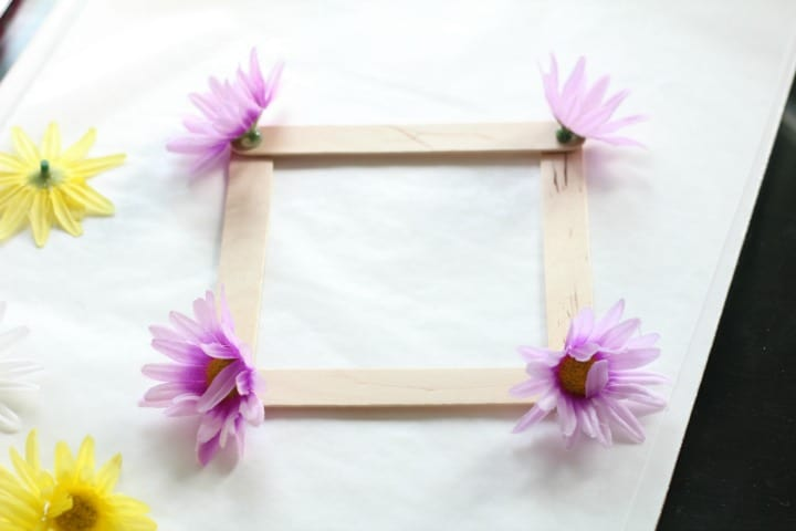 attaching the flowers to the frame cake topper