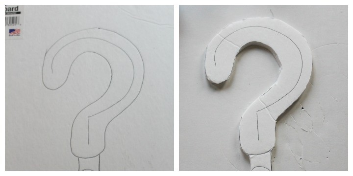 Cutting out the question mark cake topper