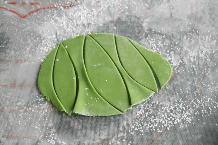 Freehand cutting the fondant leaves
