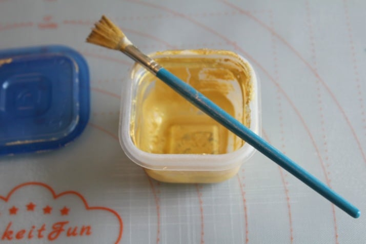 mixing the gold luster dust for the fondant leaves