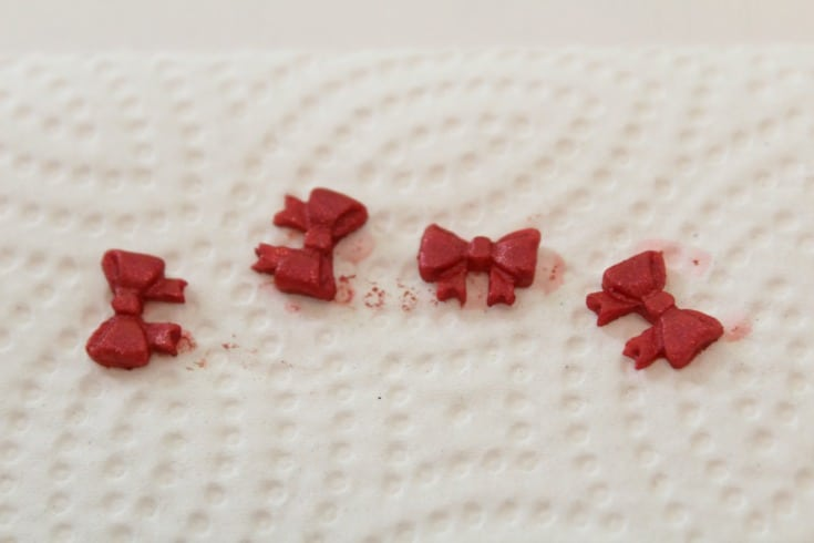 Painting the molded fondant bows