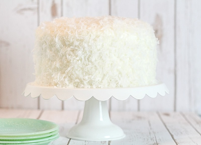 Coconut Cake on a white cake stand