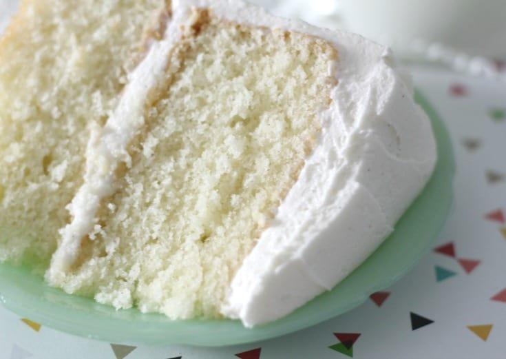 vanilla cake slice on a small green plate
