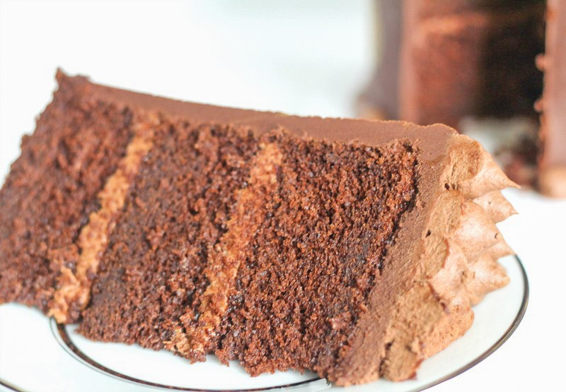 large slice of chocolate butter cake on a white plate