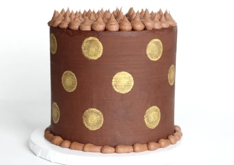 Gold Polka Dot Cake in front of white background