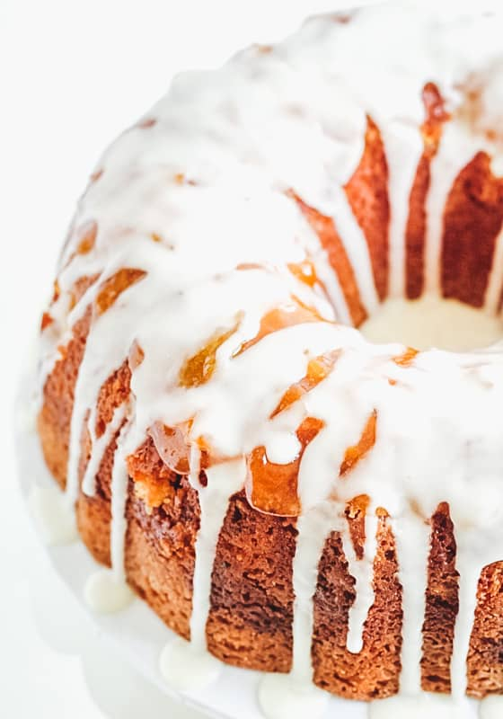 close up of apricot bundt cake with glaze