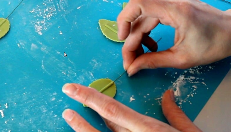 Inserting wire into gumpaste leaves