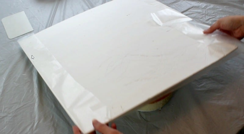 covering the large square cake board