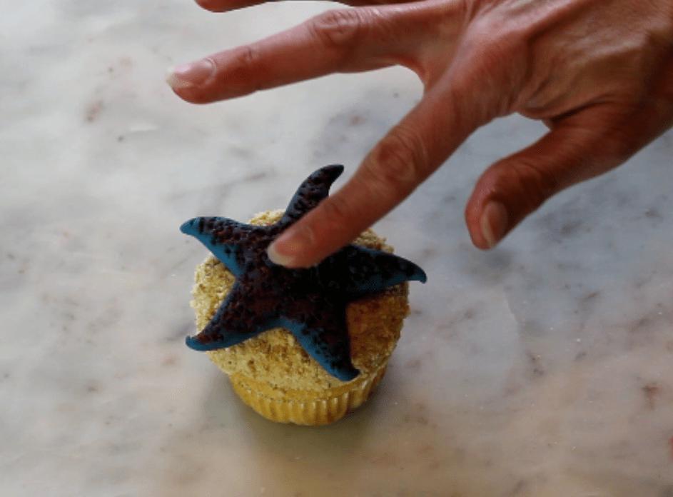 attach fondant starfish to cupcake