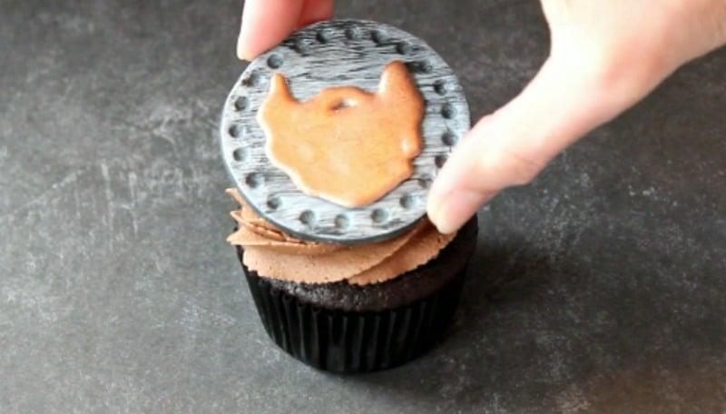 Attaching beard cupcake topper to cupcake