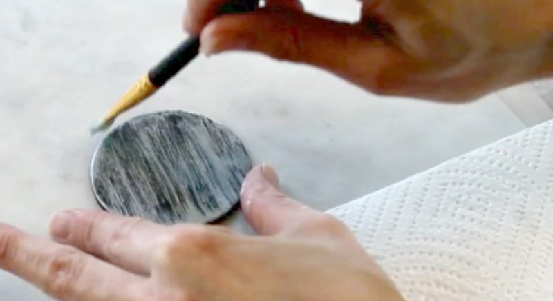 Adding silver dust to black fondant cupcake toppers