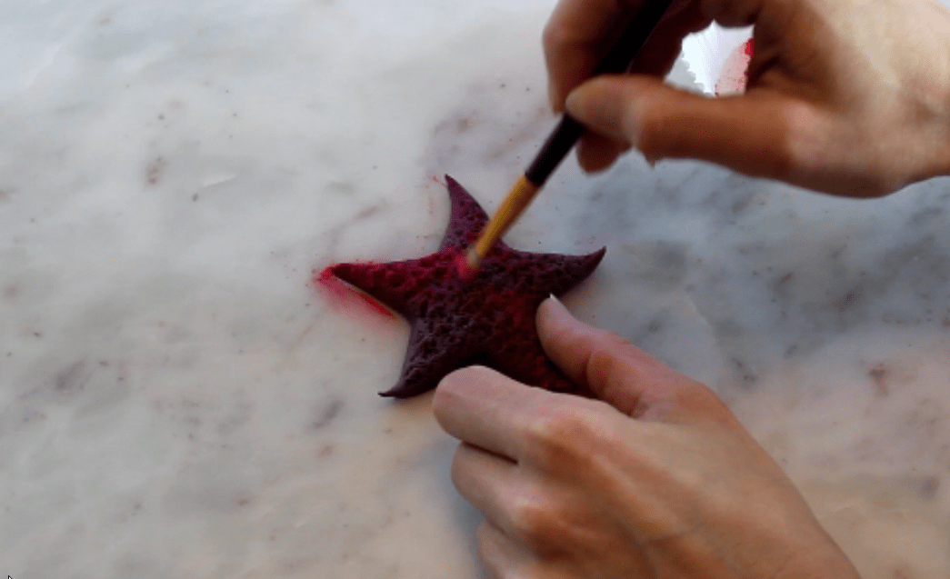 dusting purple fondant starfish with pink dust