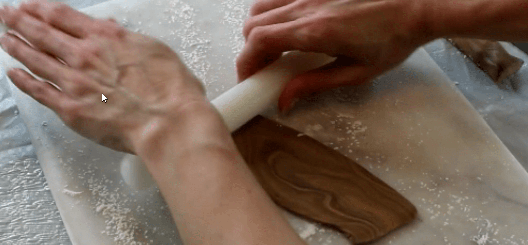 Rolling out the woodgrain fondant