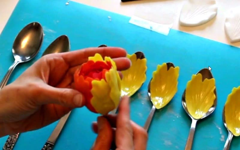Attaching yellow gumpaste peony petals to base