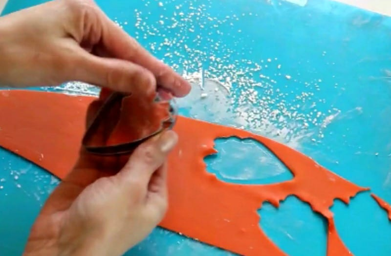 Cutting out orange gumpaste peony petals