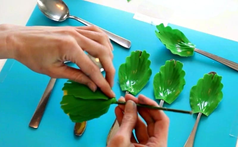 Attaching green gumpaste peony petals to base