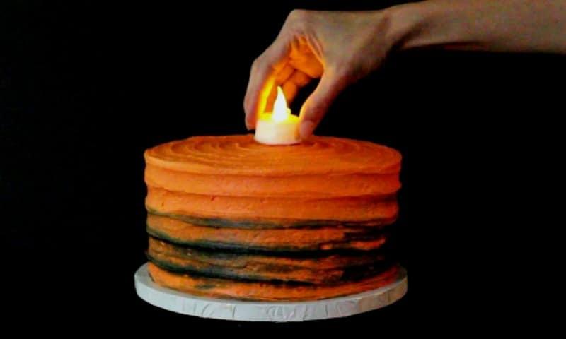 Adding tealight to cake