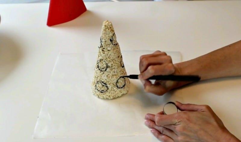 Making circles on rice krispie hat