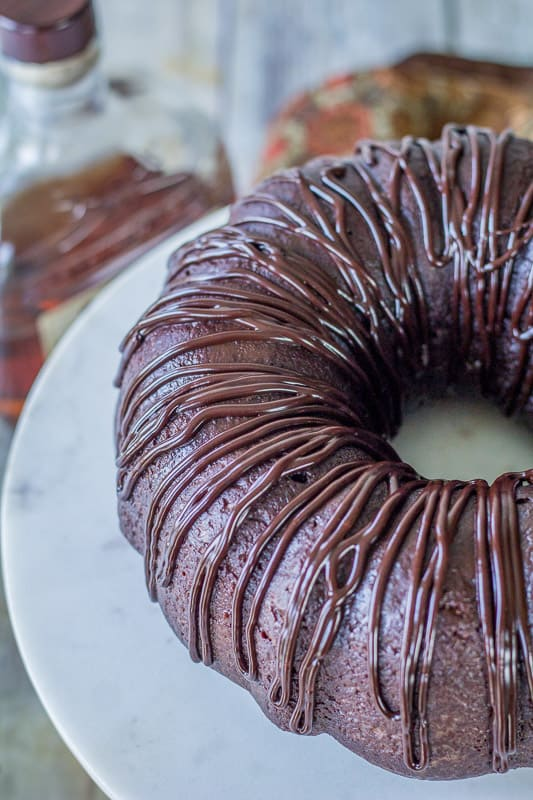 Side view of Chocolate Rum Cake on a marble cake stand