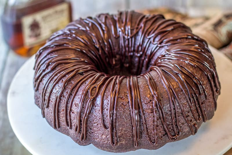 Chocolate Rum Cake on a marble cake stand