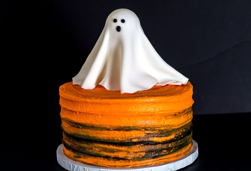 Glowing Fondant Ghost on orange and black cake