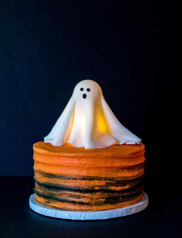 Glowing Fondant Ghost topper on orange cake