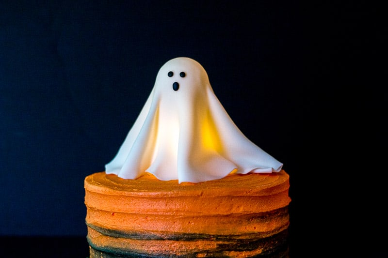 Glowing Ghost Cake Topper on top of orange cake