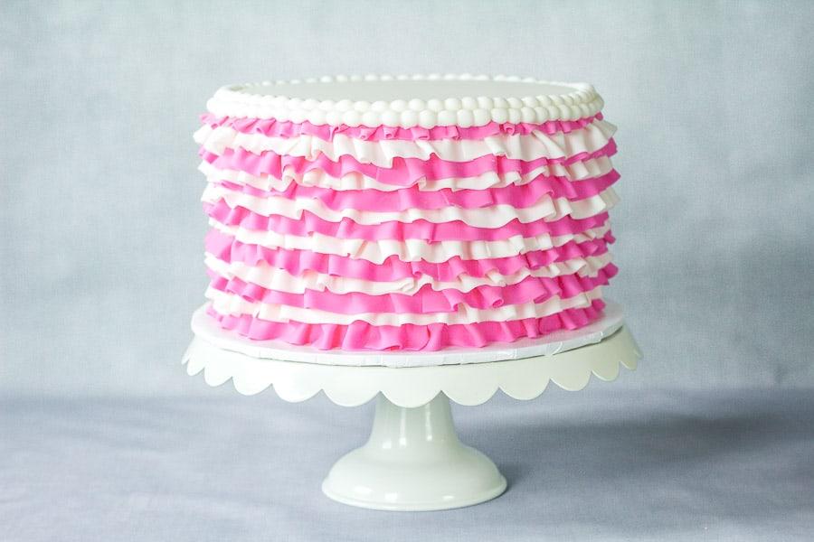 Pink and white fondant ruffled cake