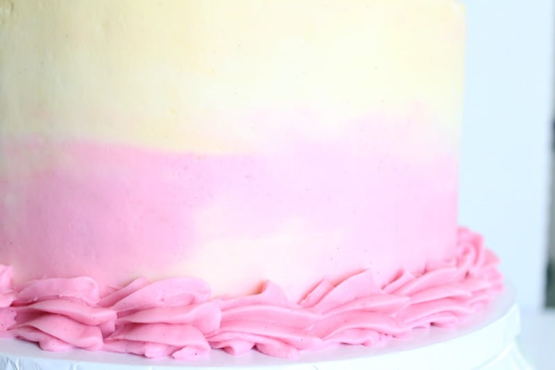 Watercolor buttercream on cake with buttercream large shell border