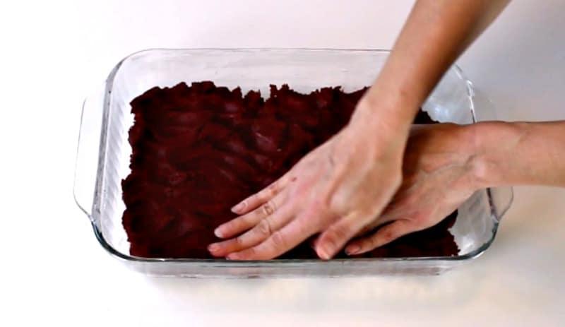 Adding cake bar mixture to baking pan