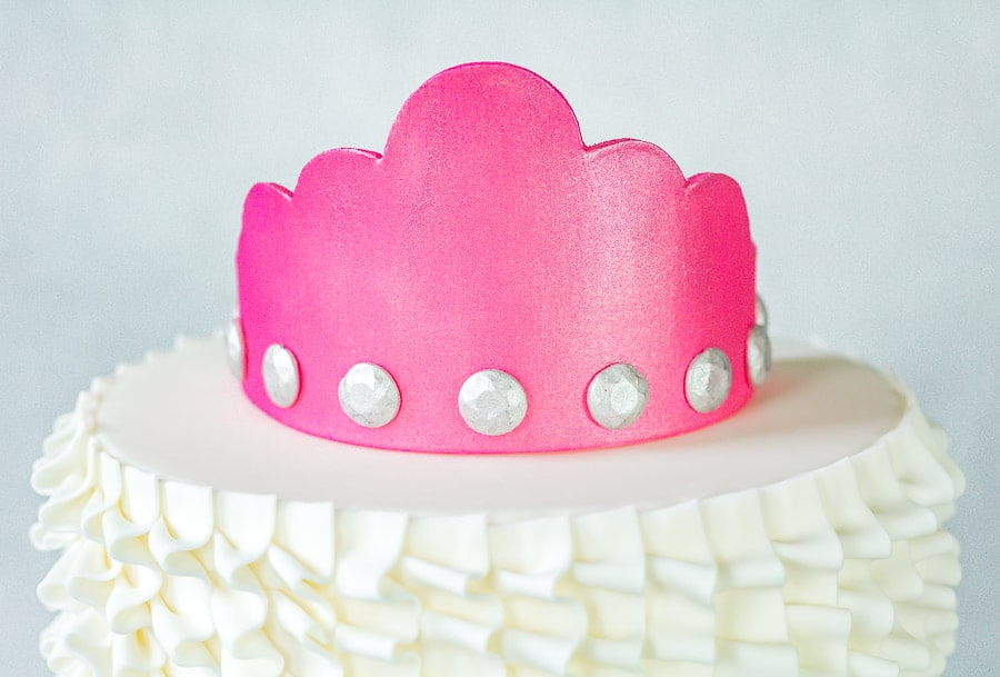 Hot Pink Gumpaste Crown on top of ruffle cake