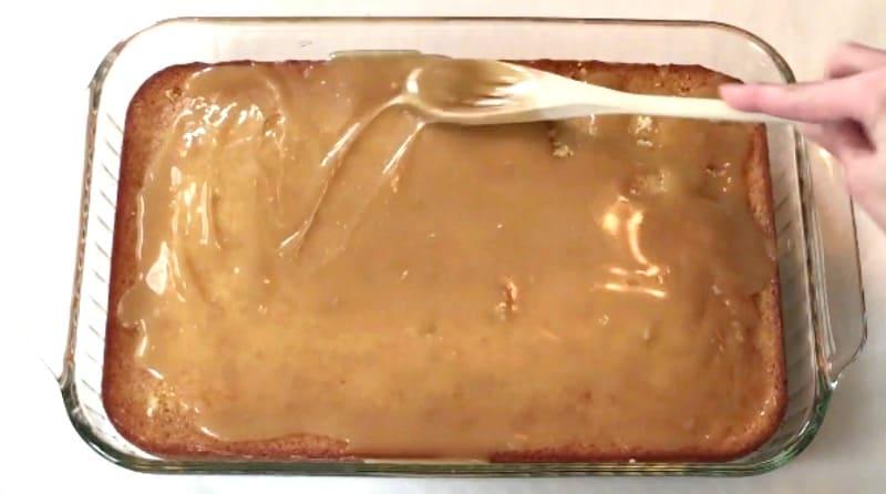 Adding honey glaze to cake