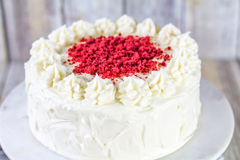 Sour Cream Red Velvet Cake on a white marble cake stand