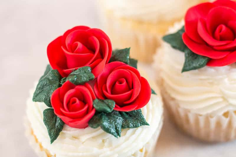 Close up of easy fondant rose on cupcake