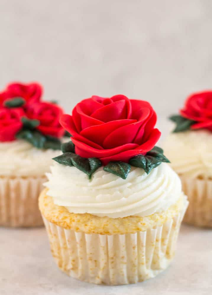 side view of fondant rose on cupcake