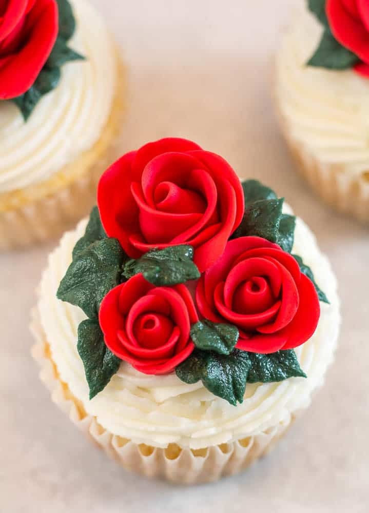 top view of three fondant roses on cupcake