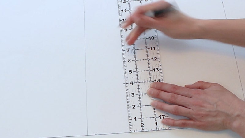 measuring in 4 inches from each side of poster board