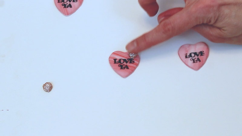 adding fondant embellishments to fondant hearts