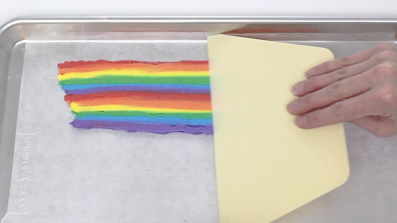 smoothing rainbow buttercream with smoother