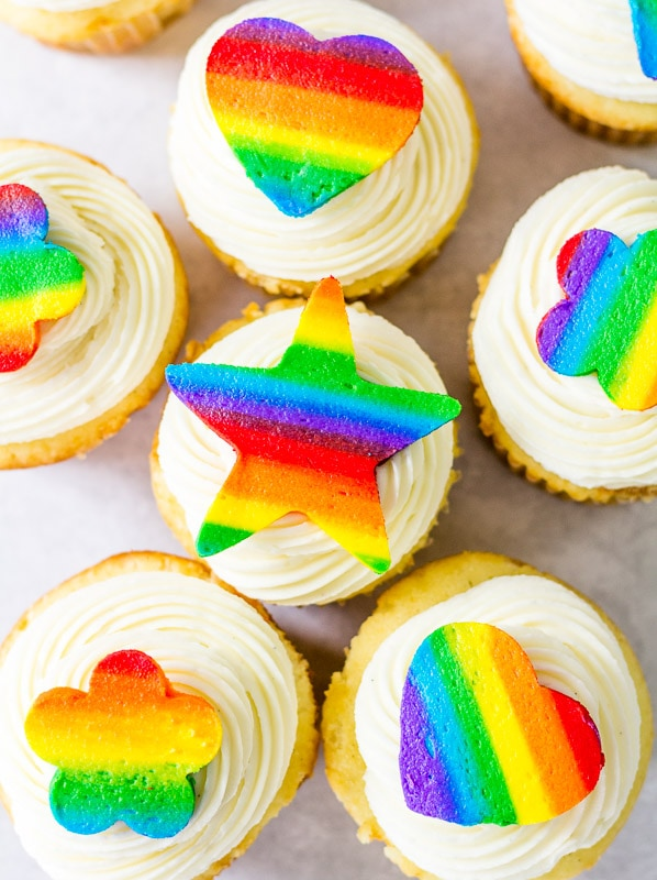 rainbow buttercream cutouts on top of cupcakes