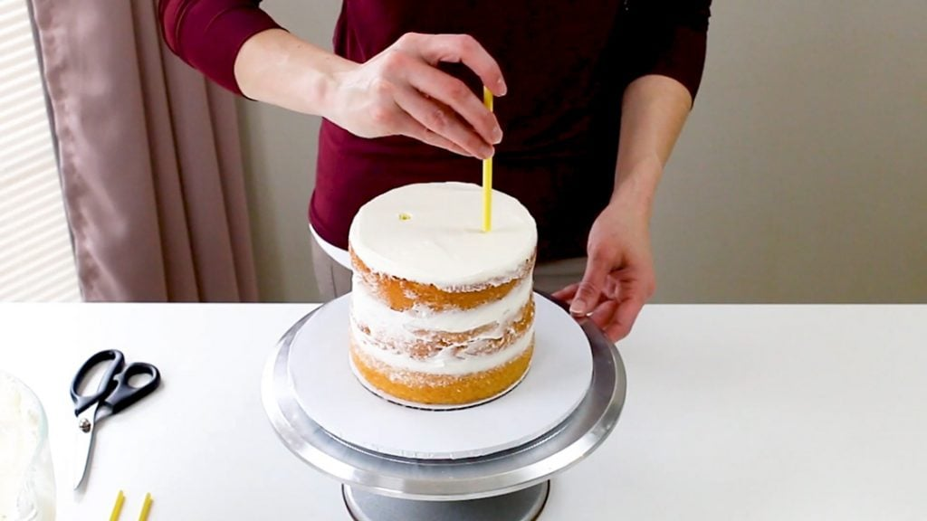 Add dowels to cake tier