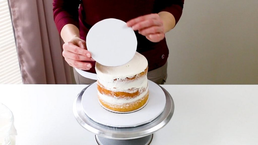 using a cake board the same size of the cake tier