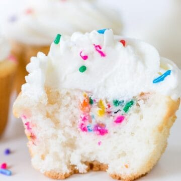 Funfetti Filled Cupcake close up with bite taken out