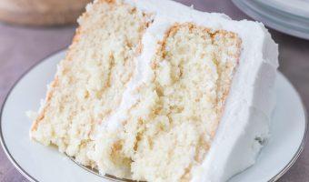 Slice of moist white cake on a white plate