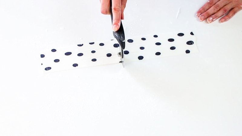 Cutting polka dot fondant in half