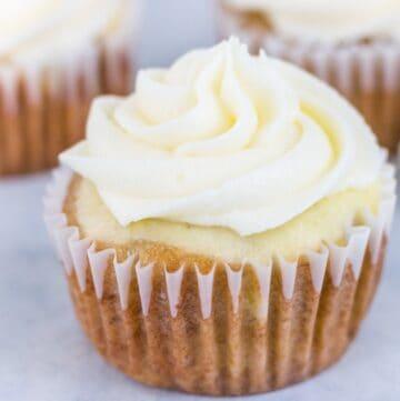 Hummingbird cheesecake topped cupcake with cream cheese buttercream swirl on top